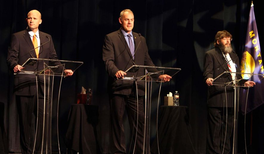 Montana U.S.  House Congressional candidates John Lewis, left, Ryan Zinke and Mike Fellows answer questions in a debate in the Montana Tech Library auditorium Saturday, June 14, 2014. (AP Photo/The Montana Standard, Walter Hinick)