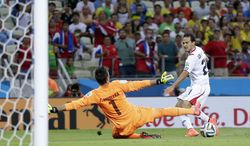 Costa Rica's Marco Urena, right, gets the ball past Uruguay's goalkeeper Fernando Muslera (1) to score Costa Rica's third goal during the group D World Cup soccer match between Uruguay and Costa Rica at the Arena Castelao in Fortaleza, Brazil, Saturday, June 14, 2014.  (AP Photo/Natacha Pisarenko)