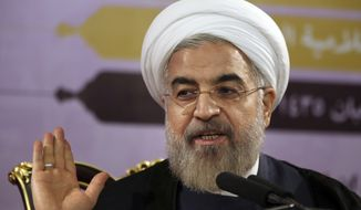 ** FILE ** Iranian President Hassan Rouhani gestures as he speaks during a press conference in Tehran, Iran, Saturday, June 14, 2014. (Associated Press)