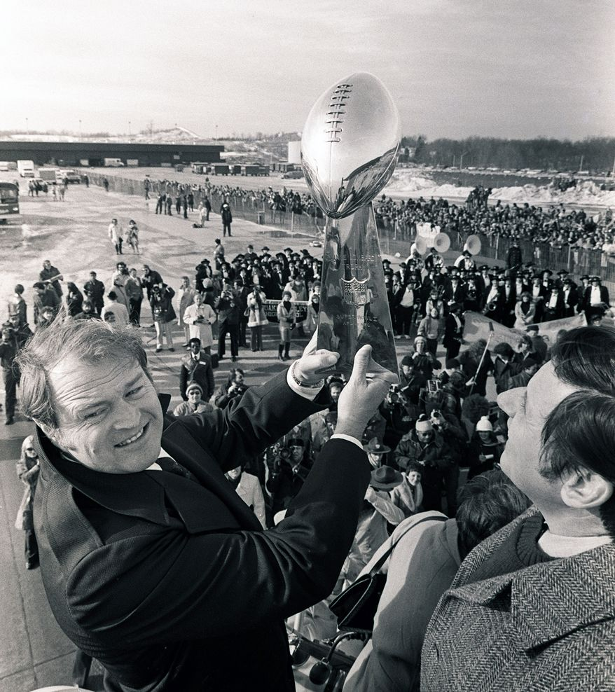 FILE - In this Jan. 19, 1979, file photo, Pittsburgh Steelers coach Chuck Noll holds the Vince Lombardi Trophy as the Steelers arrive at a Pittsburgh airport after winning the NFL football Super Bowl. Noll, the Hall of Fame coach who won a record four Super Bowl titles with the Steelers, died Friday night, June 13, 2014, at his home. He was 82. The Allegheny County (Pa.) Medical Examiner said Noll died of natural causes. (AP Photo/Harry Cabluck, File)