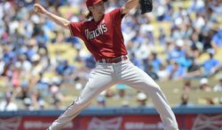 Arizona Diamondbacks' Bronson Arroyo pitches in the second inning a baseball game against the Los Angeles Dodgers, Sunday, June 15, 2014, in Los Angeles. (AP Photo/Jayne Kamin-Oncea)
