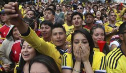 Colombia soccer fans cheer during their team's soccer World Cup game against Greece in Bogota, Colombia, Saturday, June 14, 2014. Colombia defeated Greece 3-0. (AP Photo/Javier Galeano)