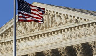 ** FILE ** This June 27, 2012, file photo shows an American flag in front of the U.S. Supreme Court in Washington. (AP Photo/Alex Brandon, File)