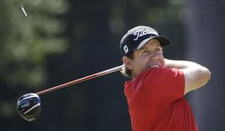 Erik Compton watches his tee shot on the third hole during the final round of the U.S. Open golf tournament in Pinehurst, N.C., Sunday, June 15, 2014. (AP Photo/David Goldman)
