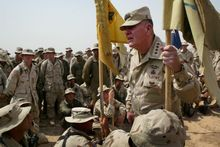 "U.S. Army Chief of Staff John Keane listens as soldiers from 1st Battalion 64 Armor Regiment ask him questions during his visit to Fallujah, Iraq Saturday, July 5, 2003. The four-star general is on a three-day visit  to see American soldiers in Iraq. One soldier asked him about a proposal to reduce the size of the Army, and he replied, "" We have our hands full. We will not reduce the Army. "" (AP Photo/John Moore)"
