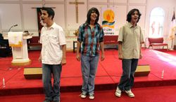 ADVANCE FOR SUNDAY, JUNE 15 - Triplets, from left, Evan, Zachary and Chase Gutierrez sing during practice Nov. 27, 2010, at Messiah United Methodist Church in Chesapeake, Va. The three will be juniors this fall at the University of Hartford's Hartt School, a performing arts conservatory founded in 1920. They earned full scholarships to continue their musical studies. (AP Photo/The Virginian-Pilot, Ross Taylor)