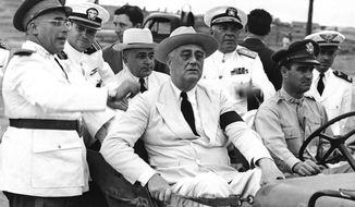 In this image provided by the U.S. Army Air, President Franklin D. Roosevelt and President Getulio Vargas of Brazil in rear seat wearing white hat pause on their inspection tour of Brazil's army, navy and air forces and a Brazilian officer points to something of interest in Brazil on Feb. 1, 1943. Mr. Roosevelt stopped in Brazil en route home from Casablanca. (AP Photo/U.S. Army Air)
