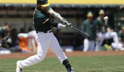Oakland Athletics' Derek Norris swings for a three-run home run off New York Yankees' Vidal Nuno in the first inning of a baseball game on Sunday, June 15, 2014, in Oakland, Calif. (AP Photo/Ben Margot)
