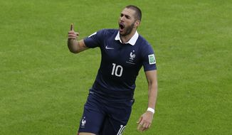 France's Karim Benzema celebrates after scoring France's 2nd goal during the group E World Cup soccer match between France and Honduras at the Estadio Beira-Rio in Porto Alegre, Brazil, Sunday, June 15, 2014.  (AP Photo/Andrew Medichini)