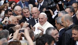 """Pope Francis arrives for a meeting with members of St. Egidio's Community in Rome, Sunday, June 15, 2014. Pope Francis is criticizing Europe for becoming """"tired"""" because of low birth rates and increasing numbers of young people who neither work nor study. Francis delivered the harsh assessment Sunday when he visited a Rome basilica, home to a Catholic organization, Sant'Egidio Community, whose volunteers help the elderly, immigrants and other needy. (AP Photo/Riccardo De Luca)"""