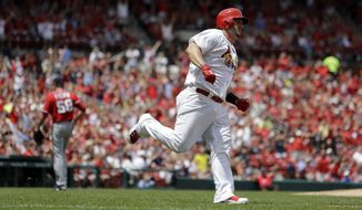 St. Louis Cardinals' Matt Adams, right, rounds the bases after hitting a two-run home run off Washington Nationals starting pitcher Doug Fister, left, during the second inning of a baseball game on Sunday, June 15, 2014, in St. Louis. (AP Photo/Jeff Roberson)