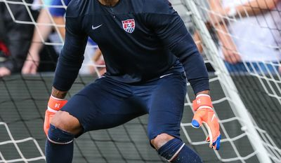 U.S. men's soccer team goalkeeper Tim Howard scrimmages during a public training session at EverBank Field in Jacksonville, Fla., Friday, June 6, 2014 before Saturday's friendly match against Nigeria ahead of the World Cup Championship. (AP Photo/The Florida Times-Union, Gary McCullough)