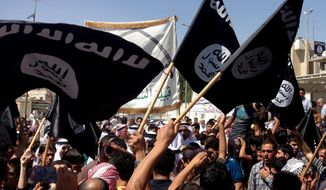 Demonstrators chant wave al Qaeda flags in front of the provincial government headquarters in Mosul, 225 miles (360 kilometers) northwest of Baghdad, Iraq. An American member of the Islamic State has said attacks on the American homeland may be imminent. (Associated Press)