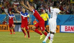 United States' John Brooks (6) celebrates with teammates after scoring his side's second goal during the group G World Cup soccer match between Ghana and the United States at the Arena das Dunas in Natal, Brazil, Monday, June 16, 2014. (AP Photo/Julio Cortez)