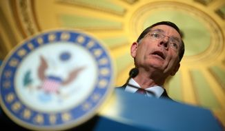 "Sen. John Barrasso, Wyoming Republican, has called Attorney General Eric H. Holder Jr. an Obama ""puppet."" (Associated Press)"