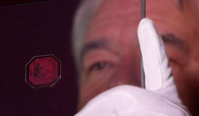 """Sotheby's Vice Chairman David Redden will direct the auction Tuesday of the British Guiana One-Cent Black on Magenta stamp. He said """"it is impossible to speculate"""" who will bid on the 1856 issue, but may include """"the people who collect the very best of everything."""" What is certain is that the winner will be very wealthy. (Associated Press)"""