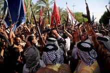 Shiite tribal fighters raise their weapons and chant slogans against the al-Qaida-inspired Islamic State of Iraq and the Levant (ISIL) in Basra. Sunni militants captured a key northern Iraqi town along the highway to Syria early on Monday, compounding the woes of Iraq's Shiite-led government a week after it lost a vast swath of territory to the insurgents in the country's north.  (associated press)
