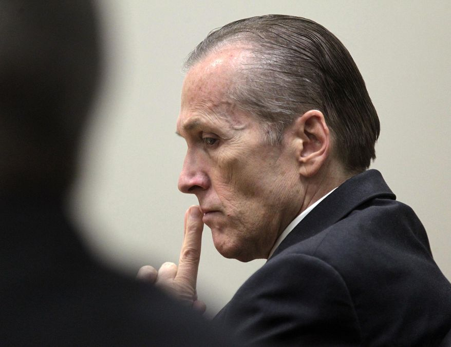 FILE - In this Nov. 7,  2013, file photo, shows Martin MacNeill listening to Gypsy Willis testify during his murder trial in 4th District Court in Provo, Utah. MacNeill is charged with one count of forcible sexual abuse of an adult female relative. (AP Photo/The Salt Lake Tribune, Al Hartmann, Pool, File)