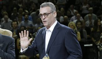 San Antonio Spurs general manager R.C. Buford with his NBA Executive of the Year Award prior to Game 2 of a Western Conference semifinal NBA basketball playoff series against the Portland Trail Blazers, Thursday, May 8, 2014, in San Antonio. (AP Photo/Eric Gay)