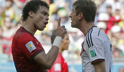Portugal's Pepe, left, argues with Germany's Thomas Mueller after they clashed during the group G World Cup soccer match between Germany and Portugal at the Arena Fonte Nova in Salvador, Brazil, Monday, June 16, 2014.  (AP Photo/Matthias Schrader)