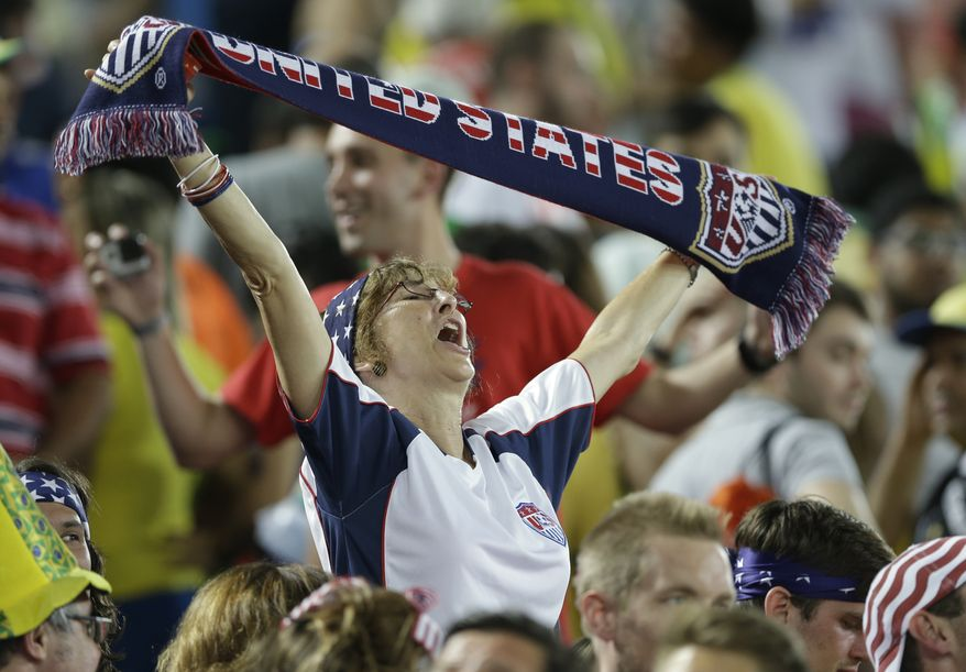 A United States fan celebrates after the group G World Cup soccer match between Ghana and the United States at the Arena das Dunas in Natal, Brazil, Monday, June 16, 2014.  The United States won the match 2-1. (AP Photo/Ricardo Mazalan)
