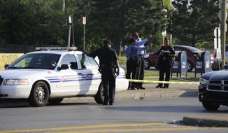 Detroit police investigate a shooting at a bus stop on Harper and Morang in Detroit on Monday, June 16, 2014. According to the Detroit Police Department, a man shot in the face at a bus stop early Monday morning walked home and woke his wife to take him to the hospital. The Detroit News and WWJ-AM report the man is in critical condition at St. John Hospital Monday after being shot around 4:30 a.m. on the city's east side.  (AP Photo/The Detroit News, David Coates)