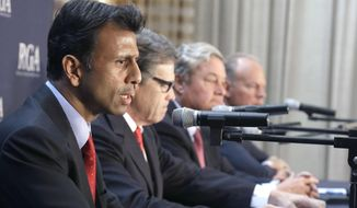 Members of the Republican Governors Association, from left, Louisiana Gov. Bobby Jindal, Gov. Texas Gov. Rick Perry, North Dakota Gov. Jack Dalrymple and Wyoming Gov. Matt Mead, speak during a press conference about Environmental Protection Agency regulations on Monday, June 16, 2014, in Houston. (AP Photo/Pat Sullivan) ** FILE **