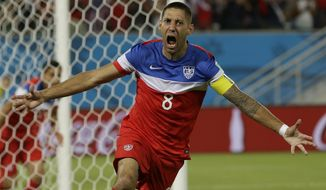 United States' Clint Dempsey celebrates after scoring the opening goal during the group G World Cup soccer match between Ghana and the United States at the Arena das Dunas in Natal, Brazil, Monday, June 16, 2014.  (AP Photo/Ricardo Mazalan)