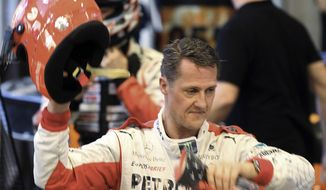 ** FILE ** In this Sunday, Dec. 16, 2012, file photo, Michael Schumacher of Germany finishes a test drive prior to the Race of Champions at Rajamangala national stadium in Bangkok, Thailand. (AP Photo/Apichart Weerawong, File)
