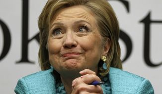"""Former Secretary of State Hillary Rodham Clinton listens to a customer signing copies of her new book """"Hard Choices,"""" at Harvard Book Store, Monday, June 16, 2014, in Cambridge, Mass. (AP Photo/Steven Senne)"""