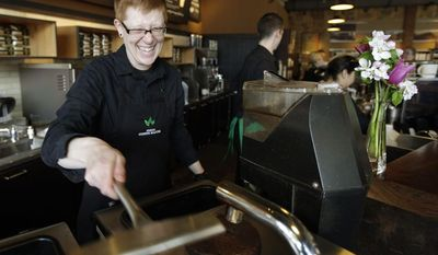 FILE - In this Friday, April 27, 2012 file photo, Starbucks barista Linsey Pringle prepares a cup of coffee at a Starbucks Corp. store in Seattle. Starbucks on Monday, June 16, 2014 announced a new partnership with Arizona State University to make online degrees available to its 135,000 U.S. employees who work at least 20 hours a week. (AP Photo/Ted S. Warren, File)
