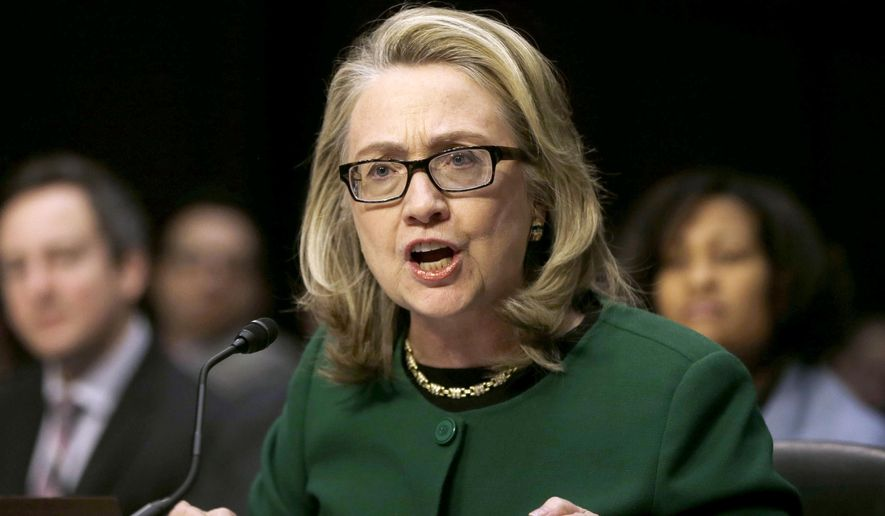 This Jan. 23, 2013 shows then-Secretary of State Hillary Rodham Clinton testifying on Capitol Hill on the deadly attack on the U.S. diplomatic mission in Benghazi, Libya, that killed Ambassador Chris Stevens and three other Americans. (AP Photo/Pablo Martinez Monsivais, File)