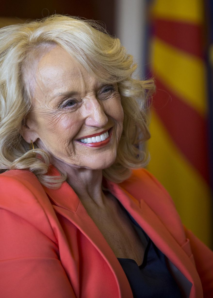 Gov. Jan Brewer smiles as she is interviewed about her years in the executive office, on Tuesday, June 17, 2014, in Phoenix, Ariz. The outgoing Arizona governor says her greatest accomplishment was leading the state out of a $3 billion deficit left from the previous administration. (AP Photo/The Arizona Republic, Charlie Leight) MARICOPA COUNTY OUT; MAGS OUT; NO SALES