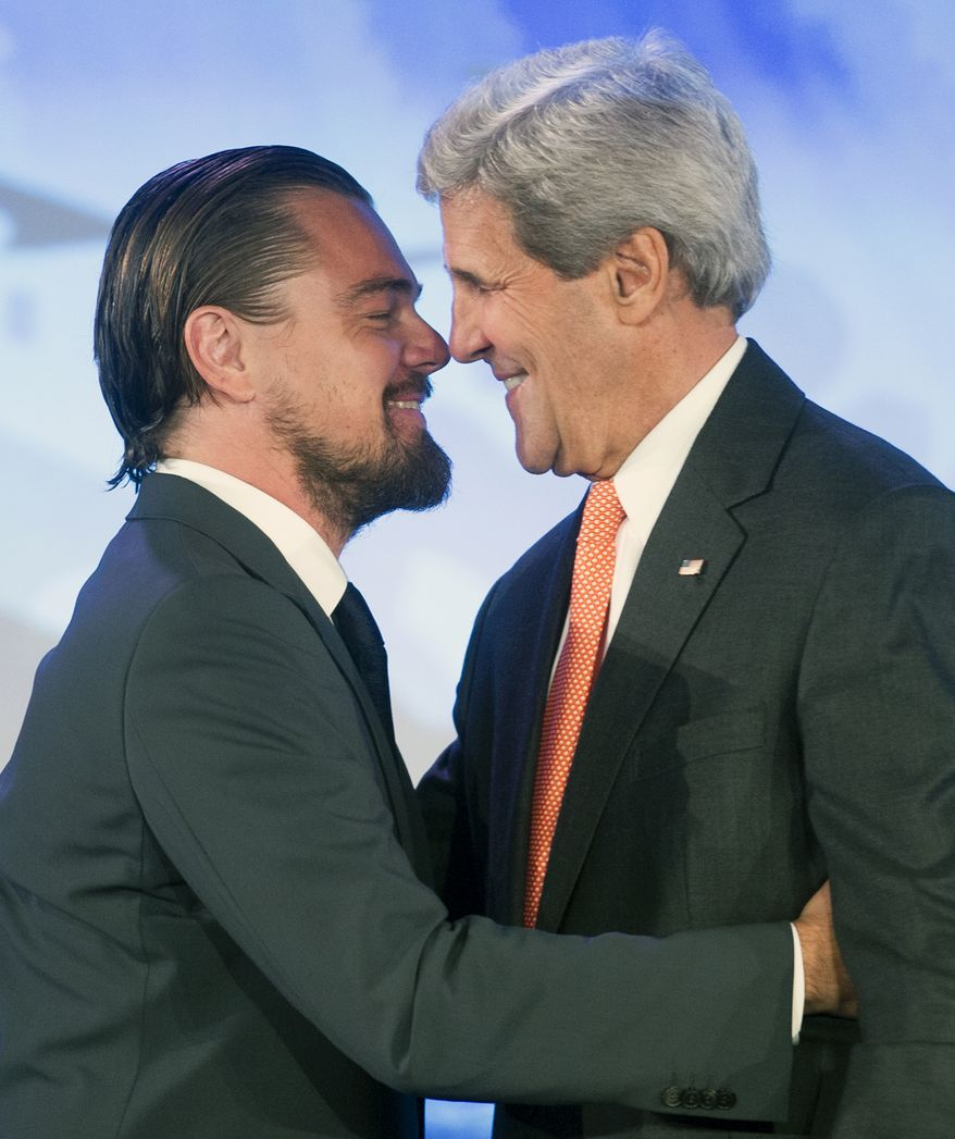 "Leonardo DiCaprio hugs Secretary of State John Kerry after Kerry introduced him at the second day of the State Department's ""Our Ocean"" conference at the State Department in Washington, Tuesday, June 17, 2014. (AP Photo/Cliff Owen)"