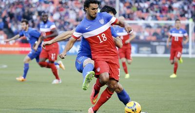 United States' Chris Wondolowski (18) is defended by Azerbaijan's Rasim Ramaldanov during the first half of an international friendly soccer match on Tuesday, May 27, 2014, in San Francisco. (AP Photo/Marcio Jose Sanchez)