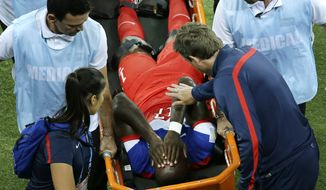 United States' Jozy Altidore is carried off the field during the group G World Cup soccer match between Ghana and the United States at the Arena das Dunas in Natal, Brazil, Monday, June 16, 2014. (AP Photo/Hassan Ammar)