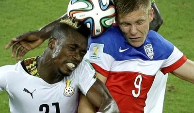 Ghana's John Boye, left, and United States' Aron Johannsson go for a header during the group G World Cup soccer match between Ghana and the United States at the Arena das Dunas in Natal, Brazil, Monday, June 16, 2014. (AP Photo/Hassan Ammar)