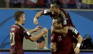 Russia's Alexander Kerzhakov (11) celebrates after scoring his side's first goal during the group H World Cup soccer match between Russia and South Korea at the Arena Pantanal in Cuiaba, Brazil, Tuesday, June 17, 2014. (AP Photo/Kirsty Wigglesworth)