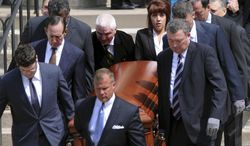 Pallbearers carry the casket of Chuck Noll, the former Pittsburgh Steelers NFL football coach, out of Saint Paul Cathedral after a funeral service Tuesday, June 17, 2014, in Pittsburgh. Noll, a Hall of Fame coach who won four Super Bowls with the Steelers in the 1970s, died last Friday at age 82. (AP Photo/John Heller)