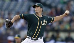 Oakland Athletics' Drew Pomeranz works against the Texas Rangers in the first inning of a baseball game Monday, June 16, 2014, in Oakland, Calif. (AP Photo/Ben Margot)