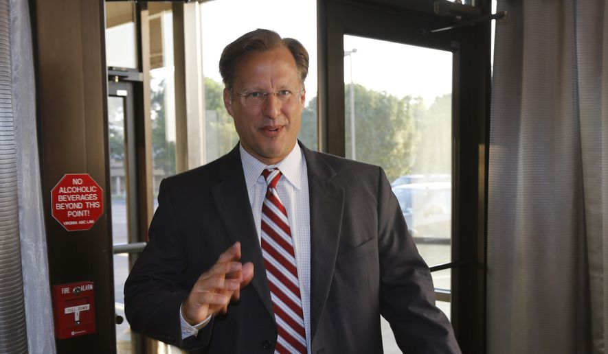 **FILE** Republican 7th District congressional candidate Dave Brat gives a statement prior to a Rotary Club breakfast in Richmond, Va., on June 17, 2014. Brat defeated House Majority Leader Eric Cantor in last week's Republican primary. (AP Photo/Steve Helber)