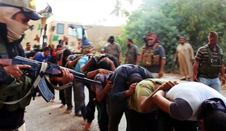 FILE - This file image posted on a militant website on Saturday, June 14, 2014, which has been verified and is consistent with other AP reporting, appears to show militants from the al-Qaida-inspired Islamic State of Iraq and the Levant leading away captured Iraqi soldiers dressed in plain clothes after taking over a base in Tikrit, Iraq. Iraq's military has been deeply shaken by their humiliating collapse in the face of an onslaught by Islamic militants the past two weeks. Officers talk of hardly being able to live with the shame. Commanders are under investigation for abandoning their posts. The impact is hurting efforts to rally the armed forces to fight back, with Shiite militiamen filling the void. (AP Photo via militant website, File)