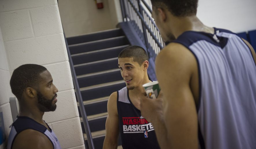 Nick Johnson (center) chats with Khem Birch (right) and Deonte Burton (left) after the Washington Wizards held a pre-draft workout at the Verizon Center in Washington, DC, Tuesday, June 17, 2014. (Photo Rod Lamkey Jr.)