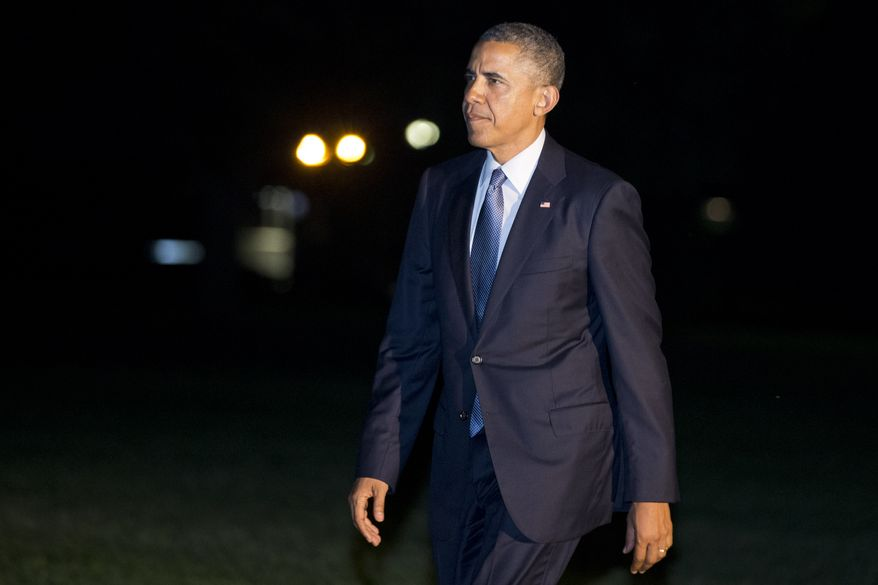 President Barack Obama walks across the South Lawn on his return to the White House from a trip to Pittsburgh and New York City, Tuesday, June 17, 2014 in Washington. (AP Photo/Jacquelyn Martin)