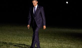 ** FILE ** President Barack Obama walks across the South Lawn after exiting the Marine One helicopter on his return to the White House from a trip to Pittsburgh and New York City, Tuesday, June 17, 2014 in Washington. (AP Photo/Jacquelyn Martin)