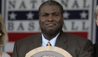 FILE - In this July 29, 2007 file photo, Tony Gwynn holds his National Baseball Hall of Fame plaque during induction ceremonies in Cooperstown, N.Y. Gwynn, the Hall of Famer with a sweet left-handed swing who spent his entire 20-year career with the Padres and was one of San Diego's most beloved athletes, died of cancer Monday, June 16, 2014. He was 54.  (AP Photo/Mike Groll, File)