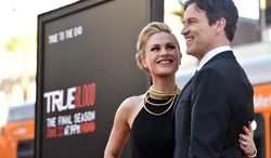 "Anna Paquin, left, and Stephen Moyer arrive at the Los Angeles premiere of the 7th and final season of ""True Blood"" at the TCL Chinese Theatre on Tuesday, June 17, 2014. (Photo by John Shearer/Invision/AP)"