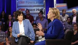 """Hillary Rodham Clinton speaks during CNN's Town Hall interview on Tuesday, June 17, 2014. The former secretary of state expressed caution Tuesday about the United States working with Iran to combat fast-moving Islamic insurgents in Iraq, saying the U.S. needs to understand """"what we're getting ourselves into."""" (AP Photo/CNN)"""