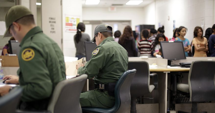 U.S. Customs and Border Protection agents work at a processing facility, Wednesday, June 18, 2014, in Brownsville,Texas. CPB provided media tours Wednesday of two locations in Brownsville and Nogales, Ariz. that have been central to processing the more than 47,000 unaccompanied children who have entered the country illegally since Oct. 1.  (AP Photo/Eric Gay, Pool)