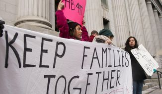 FILE - In this Feb. 15, 2013, file photo, a group of protestors gather at the Frank E. Moss Federal Courthouse, in Salt Lake City, as U.S. District Court Judge Clark Waddoups hears final oral arguments on constitutionality of HB497, Utah's immigration enforcement law passed by the Utah Legislature in 2011. A federal judge has issued a split ruling on Utah's controversial immigration law, upholding one key measure but striking down several others. U.S. District Judge Clark Waddoups' ruling Wednesday, June 18, 2014 upheld a key provision requiring authorities to check the immigration status of people arrested for felonies or Class A misdemeanors, such as theft. But he set limits on how it can be implemented. (AP Photo/The Deseret News, Scott G. Winterton, File)  SALT LAKE TRIBUNE OUT;  MAGS OUT